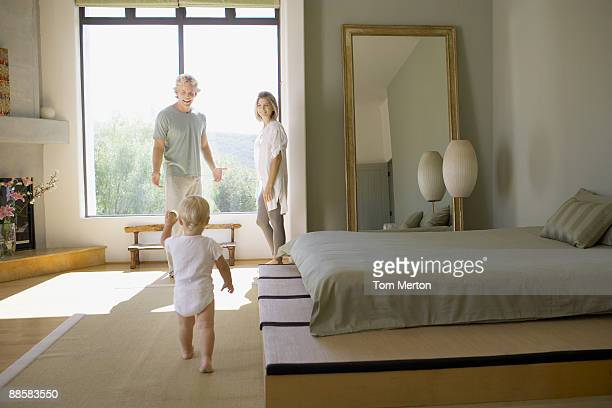 Couple and baby in bedroom
