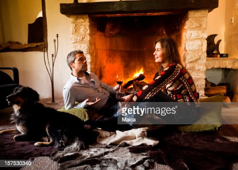 Couple and dog by the fire