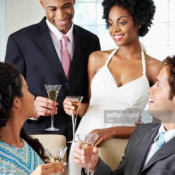 Couple and Guests Toasting at Wedding Reception