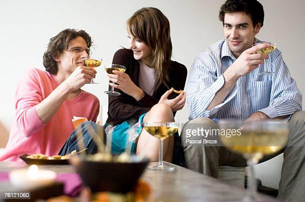 Couple and man drinking champagne