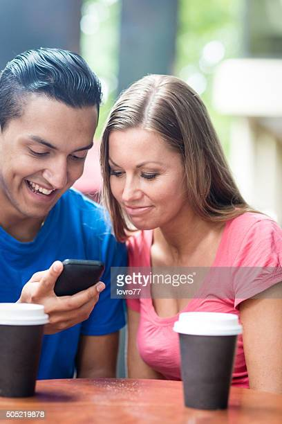 Couple and modern technology for coffee time