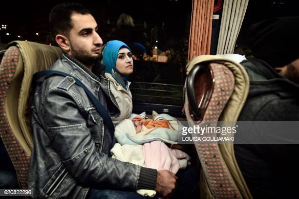 TOPSHOT A couple and their child ride a bus to the airport in Athens to take a special charter flight bound for France in the frames of the EU...