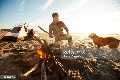 A couple and their dog camping. : Foto de stock