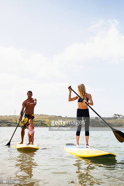 Couple and toddler daughter standup paddleboarding, Carlsbad, California, USA