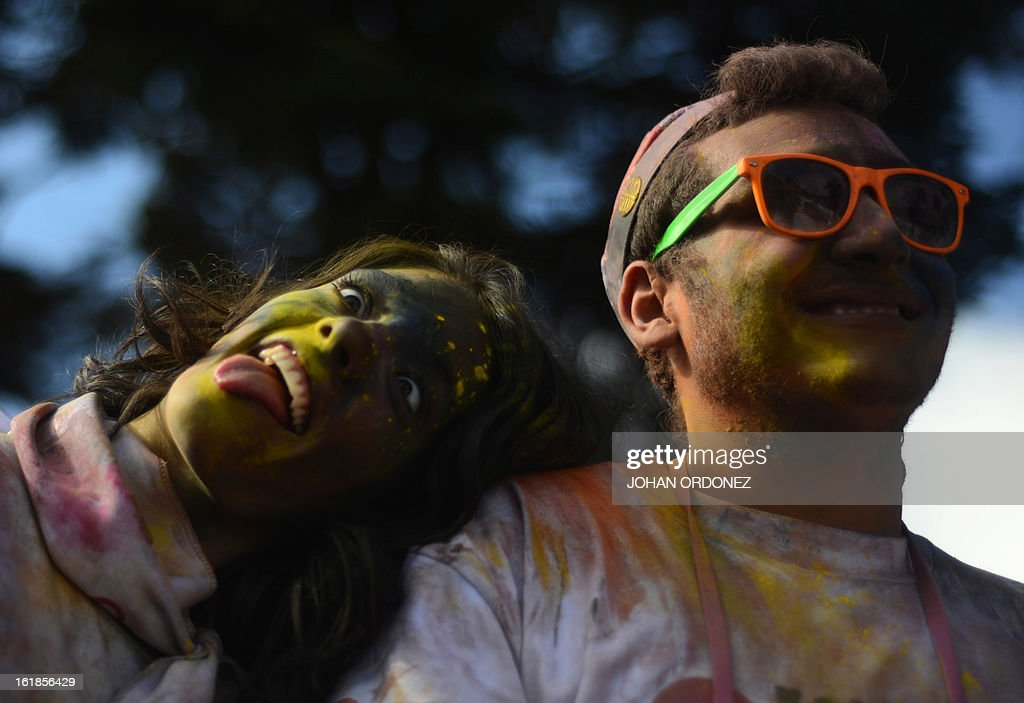 A couple are seen covered in paint powder at the end of the Kolorfest race in Guatemala City on February 17, 2013. About 1500 people participated in the event to raise money for charities. AFP PHOTO/Johan ORDONEZ