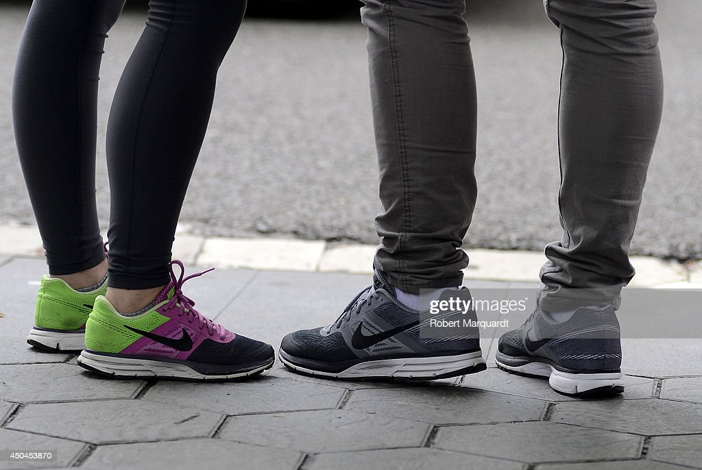 A couple are seen wearing Nike shoes on June 11, 2014 in Barcelona, Spain.