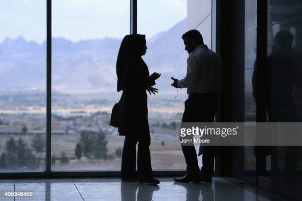A couple argues in the new Isfahan City Center shopping mall on June 2 2014 in Isfahan Iran The mall complex still under construction is the largest...