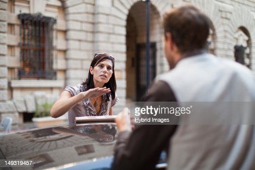 Couple arguing over sports car