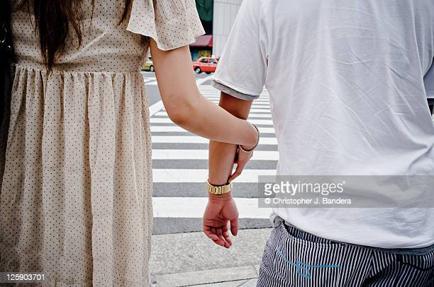 Couple arm in arm