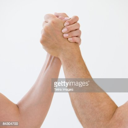 Couple arm wrestling