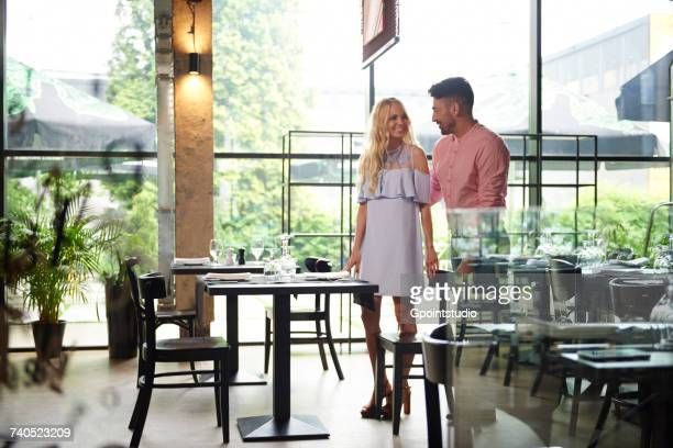Couple arriving at restaurant for lunch date