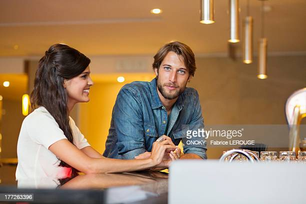 Couple at a bar counter