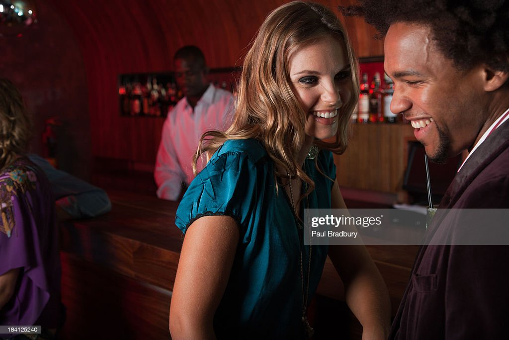 A couple at a club : Stock Photo