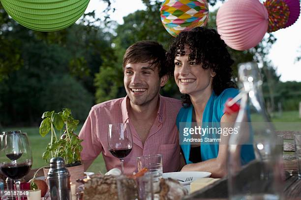 A couple at a dinner party, outdoors