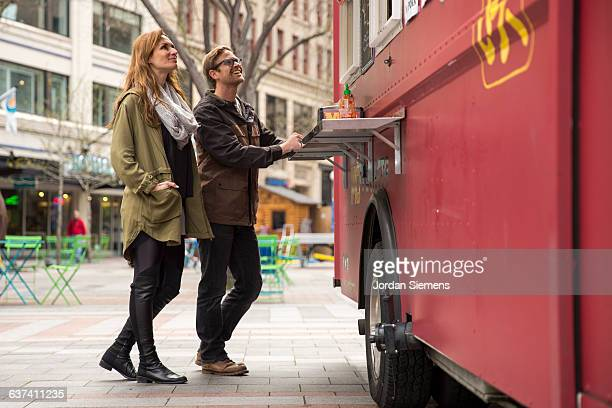 A couple at a food truck.