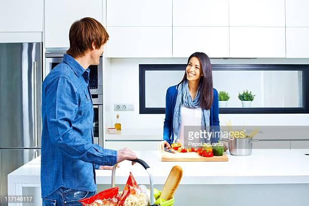 Couple at a modern kitchen.