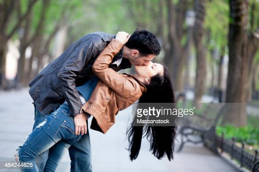 Couple at alley in city. : Stock Photo