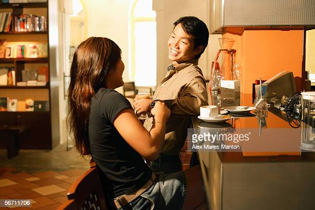 Couple at bar counter, talking