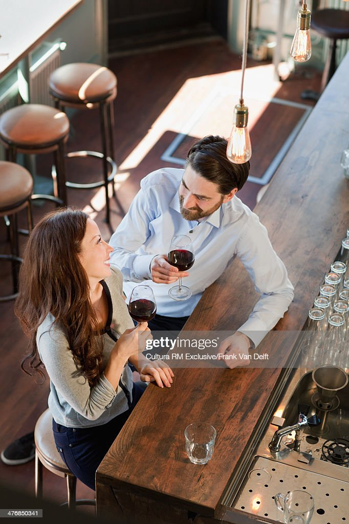 Couple at bar with red wine : Stock Photo