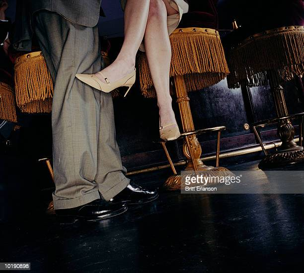 Couple at bar, woman on stool, low section