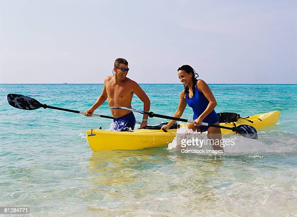Couple at beach with kayak