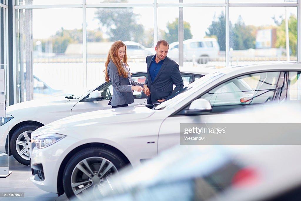Couple at car dealer