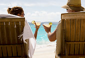 couple at the beach making a toast