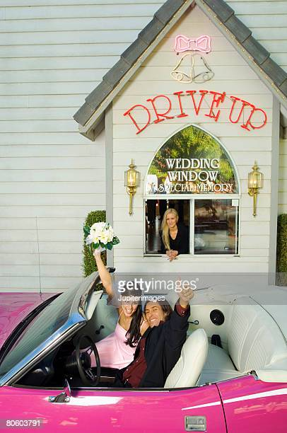 Couple at drive up wedding chapel