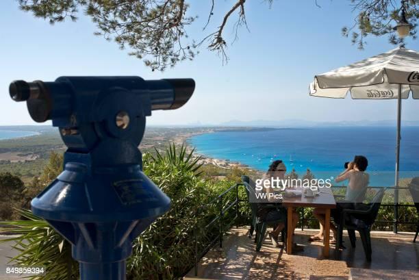 Couple at Es Mirador bar and restaurant Ibiza and Es Vedra rock at the sunset FORMENTERA Balearic Islands SPAIN