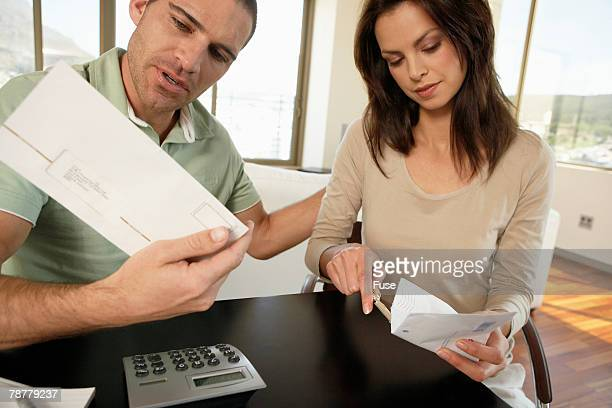 Couple at Home Organizing Finances