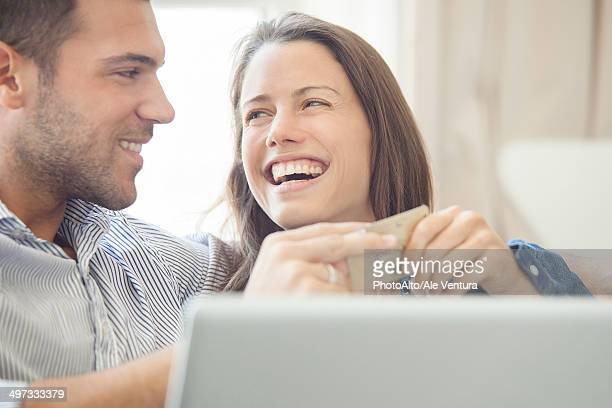 Couple at home shopping online together