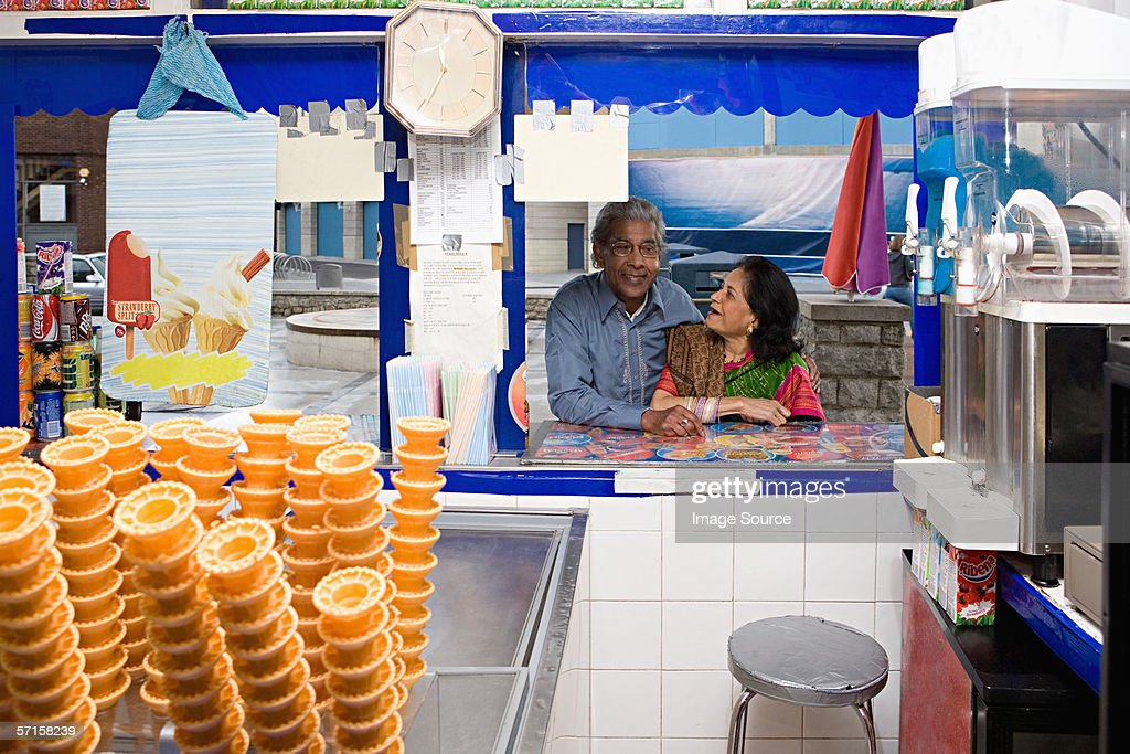 Couple at ice cream kiosk : Stock Photo