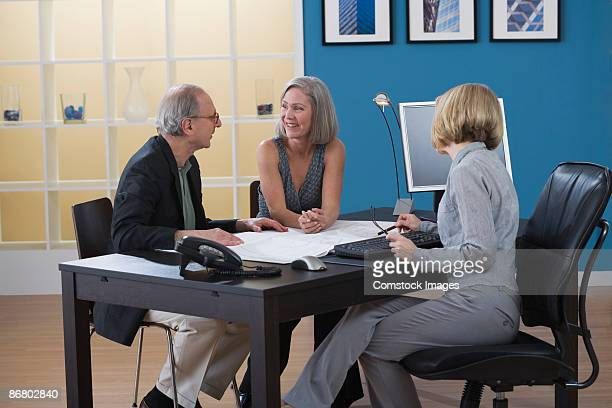 Couple at meeting with businesswoman