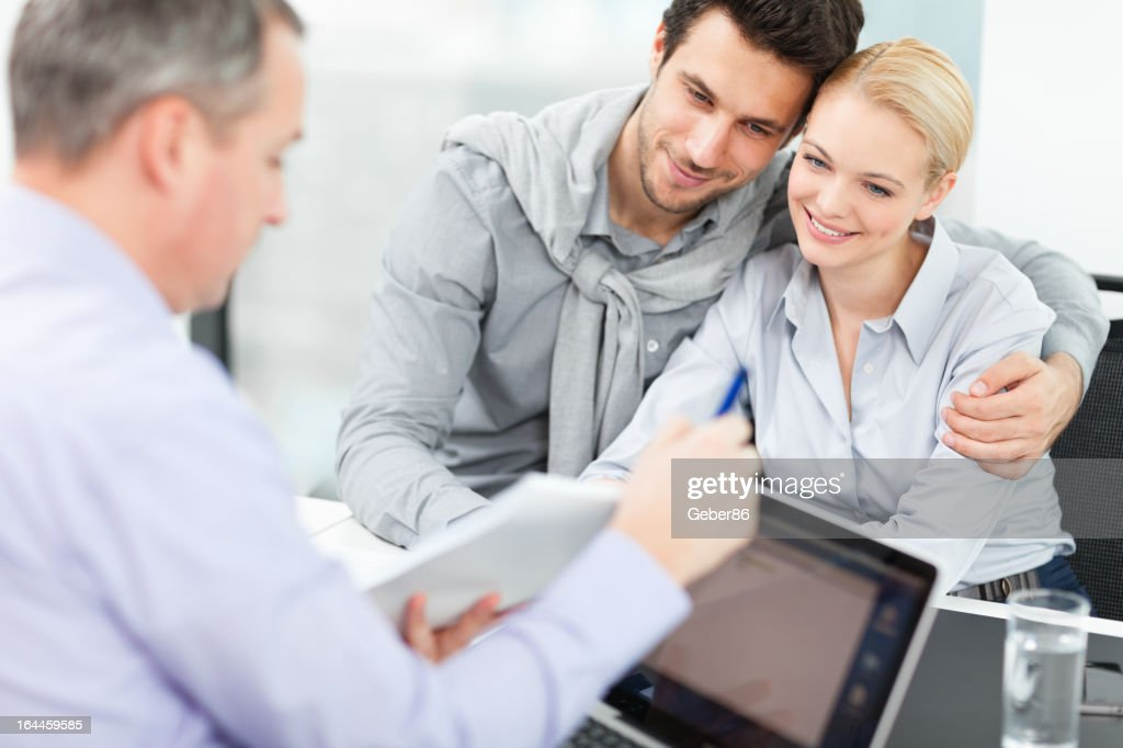 Couple at meeting with financial advisor : Stock Photo