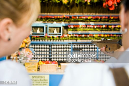 Couple at shooting gallery on the Oktoberfest in Munich, Bavaria, Germany