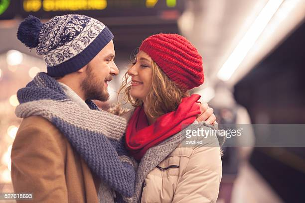 Couple at subway station waiting for train.