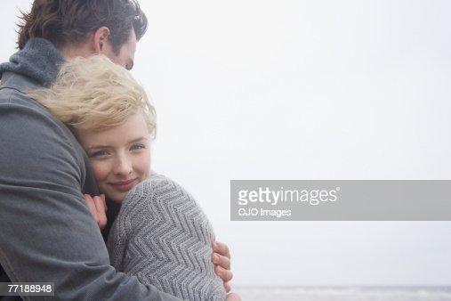 A couple at the beach : Foto de stock
