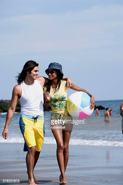 Couple at the beach with a beach ball
