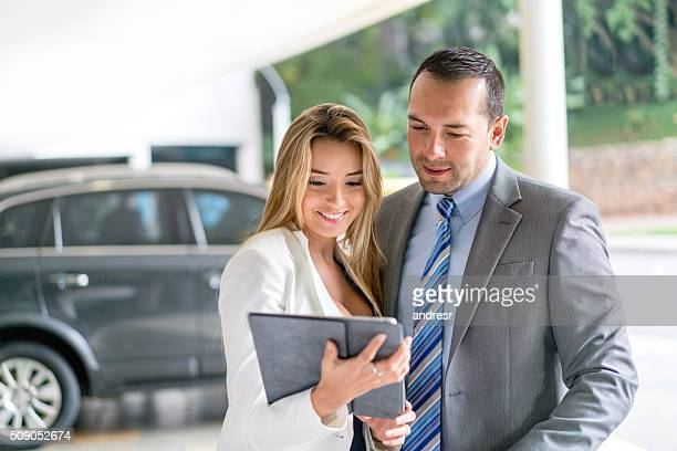Couple at the car dealership