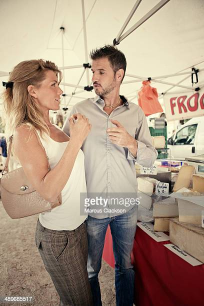Couple at the cheese stall in Provence France