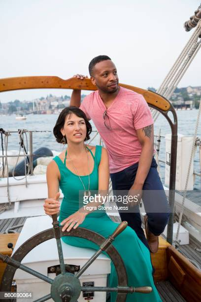 Couple at the wheel of sailboat