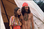 A couple attending the Woodstock Music Festival smiles while standing outside the shelter they've built during the concert Bethel NY August 1969