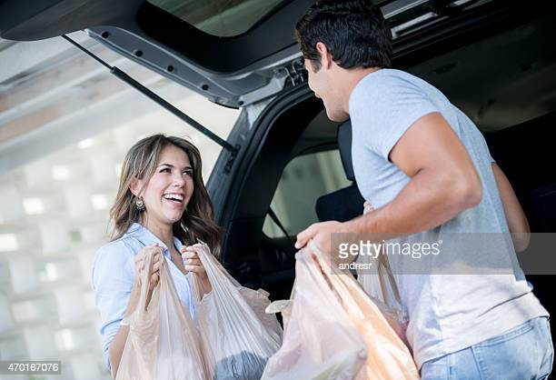 Couple back at home with the groceries