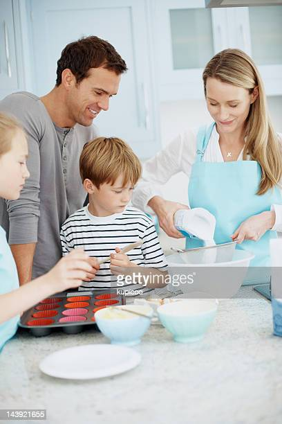 Couple baking with kids