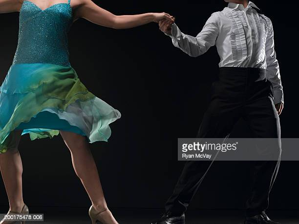 Couple ballroom dancing, low section