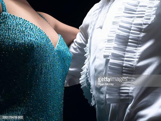 Couple ballroom dancing, mid section