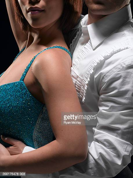 Couple ballroom dancing, mid section, side view