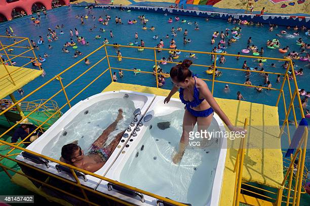 A couple bath in Meixin Park in Yangren Jie in Nan'an District on July 17 2015 in Chongqing China As high temperature came with summer citizens in...