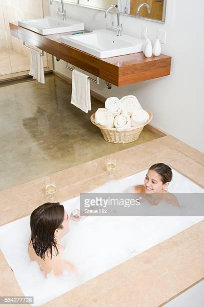 nude couples bathing together