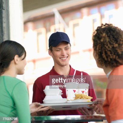 Couple being served fast food : Stock Photo